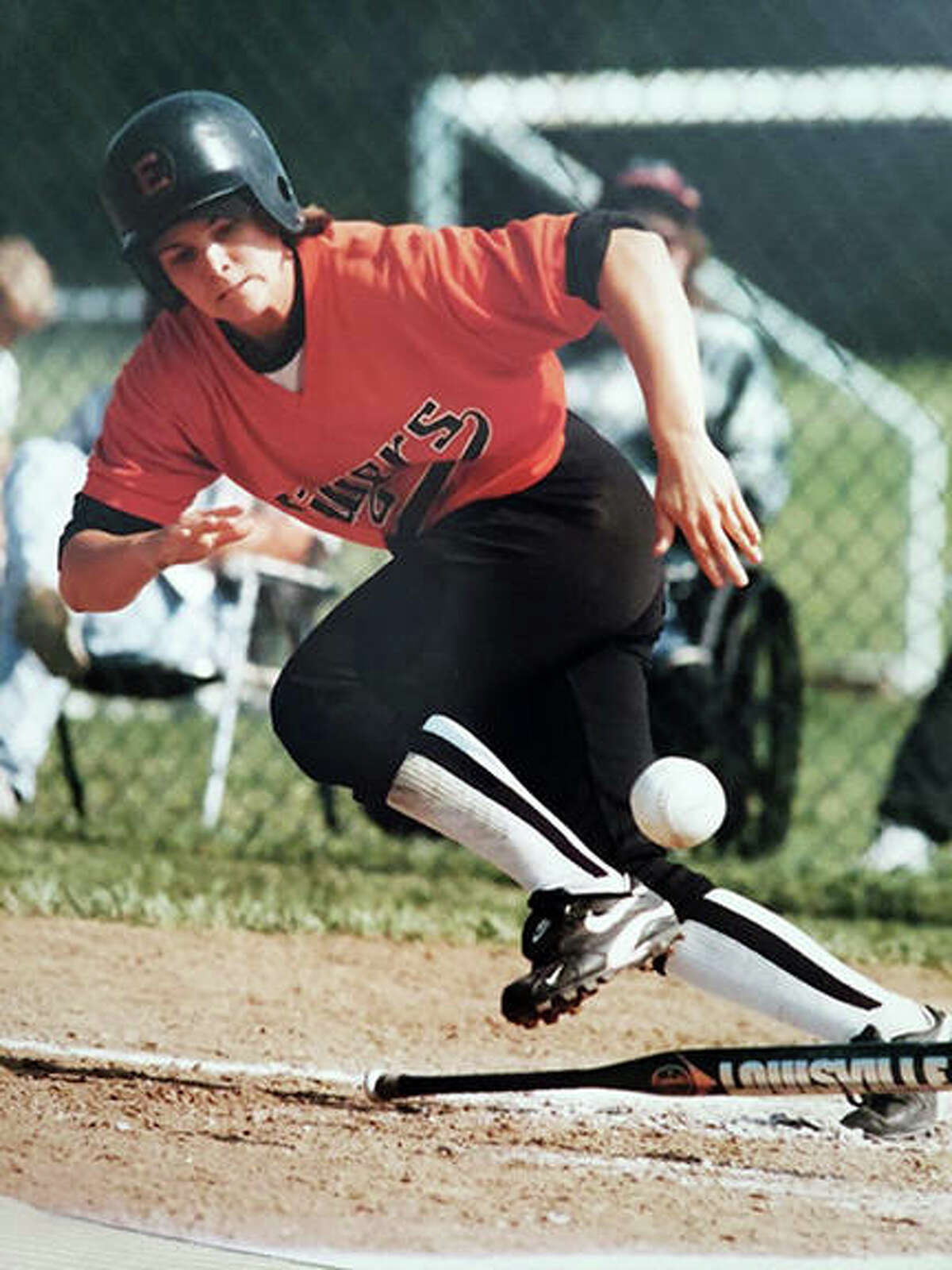 Jacque Woosley, a 1998 Edwardsville graduate, lays down a bunt during her softball playing days at EHS.