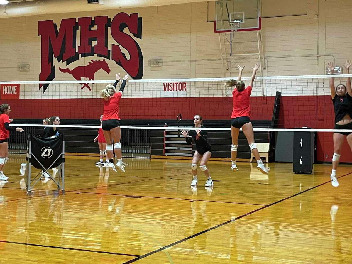 The Memorial volleyball team works on a blocking drill during practice on Aug. 5.