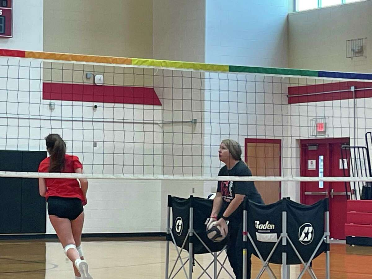 Memorial volleyball coach Kaddie Platt sets up balls during practice on Aug. 5.