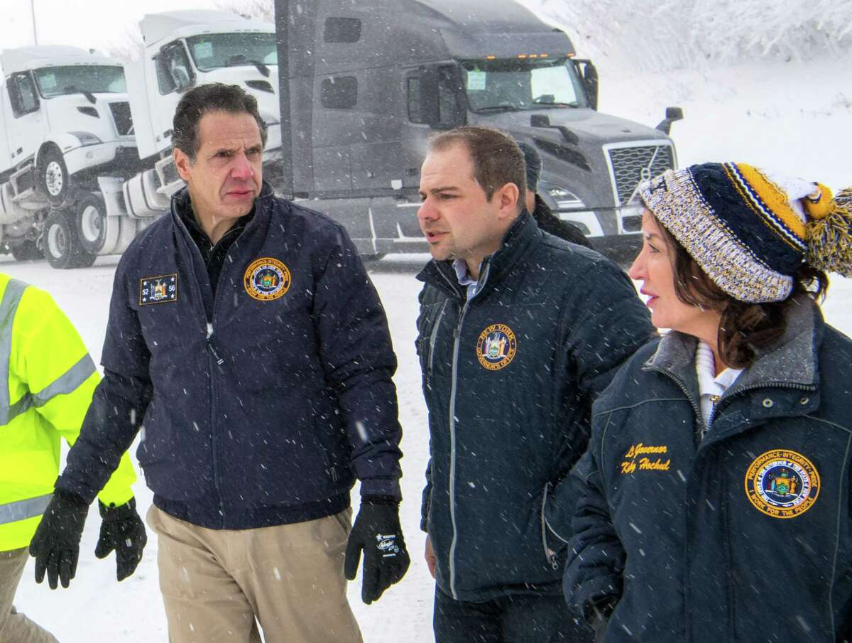 Gov. Andrew Cuomo, left, Rich Azzopardi, director of communications and senior advisor to the governor, center, and Lt. Gov. Kathy Hochul, right, travel to closed Skyway Highway in Buffalo to view its condition and confronts truckers not hearing to Truck/Bus travel ban along the way on Jan. 31, 2019, in Buffalo, N.Y. (Office of the governor)