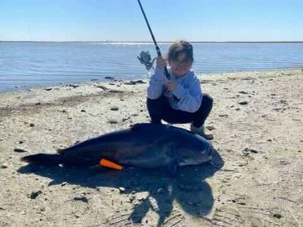 Aubrie Mia Guerra, now 7-years-old, hooked her 50-pound, 44-inch long blue catfish while fishing with her father at Lake Corpus Christi on January 15.