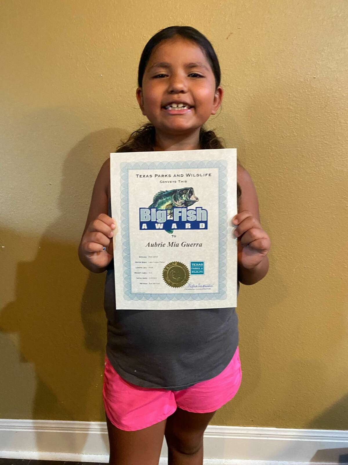 """On July 30, Texas Parks and Wildlife Department awarded Aubrie with the """"Big Fish Award"""" in the junior angler division. It's given when a fish met or exceeded the minimum length requirements for its species."""