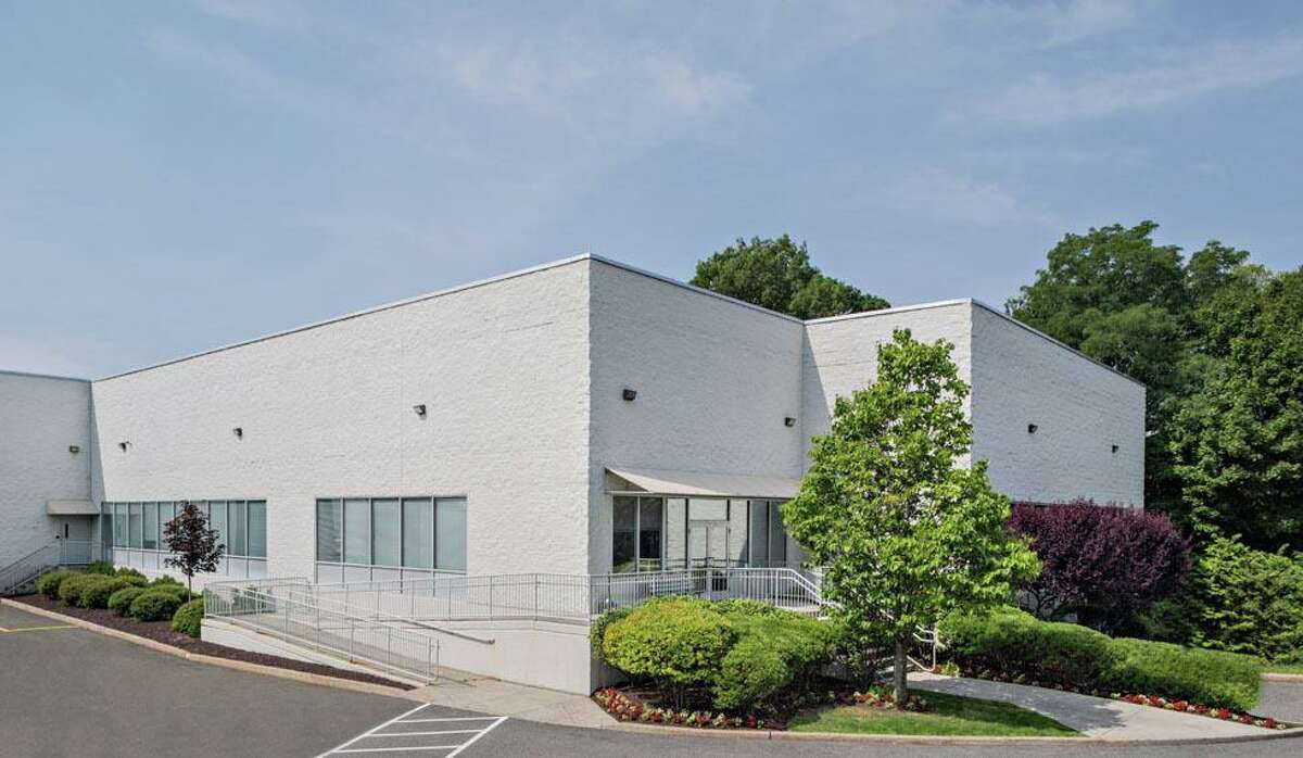 This building at 650 Ave., in Stamford, Conn., and a neighboring building at 419 West Ave., have been sold for a total of $20.5 million.