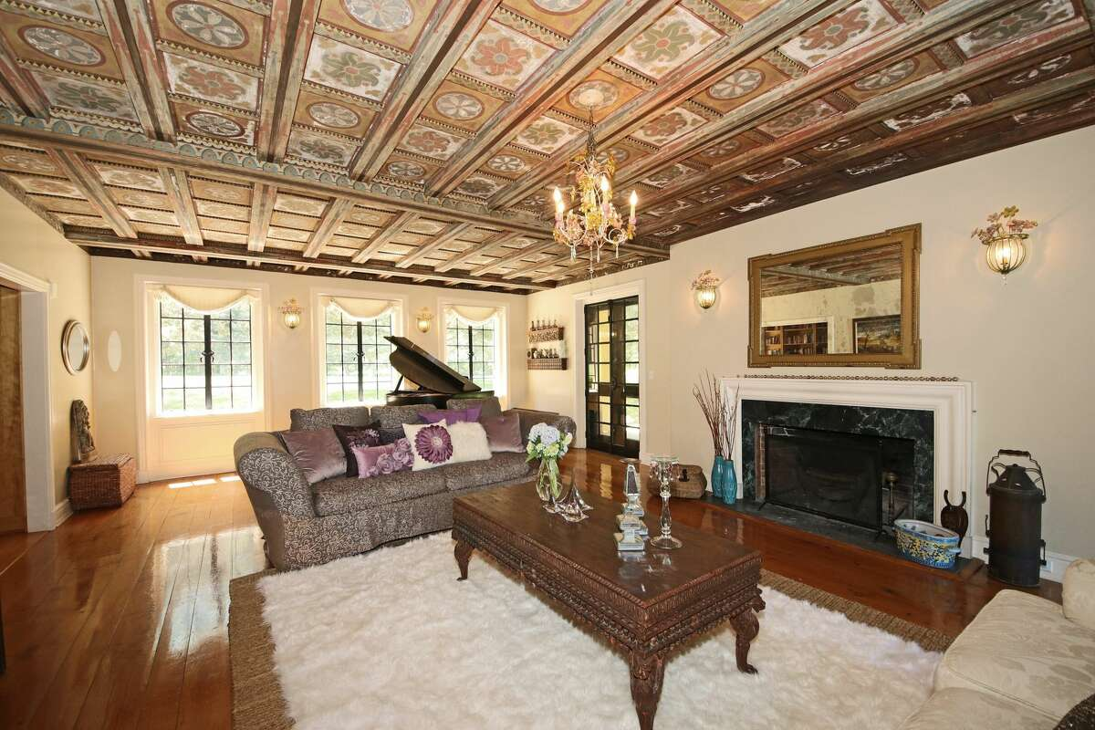 The formal living room in the Stormfield estatehas a hand-painted, coffered ceiling.
