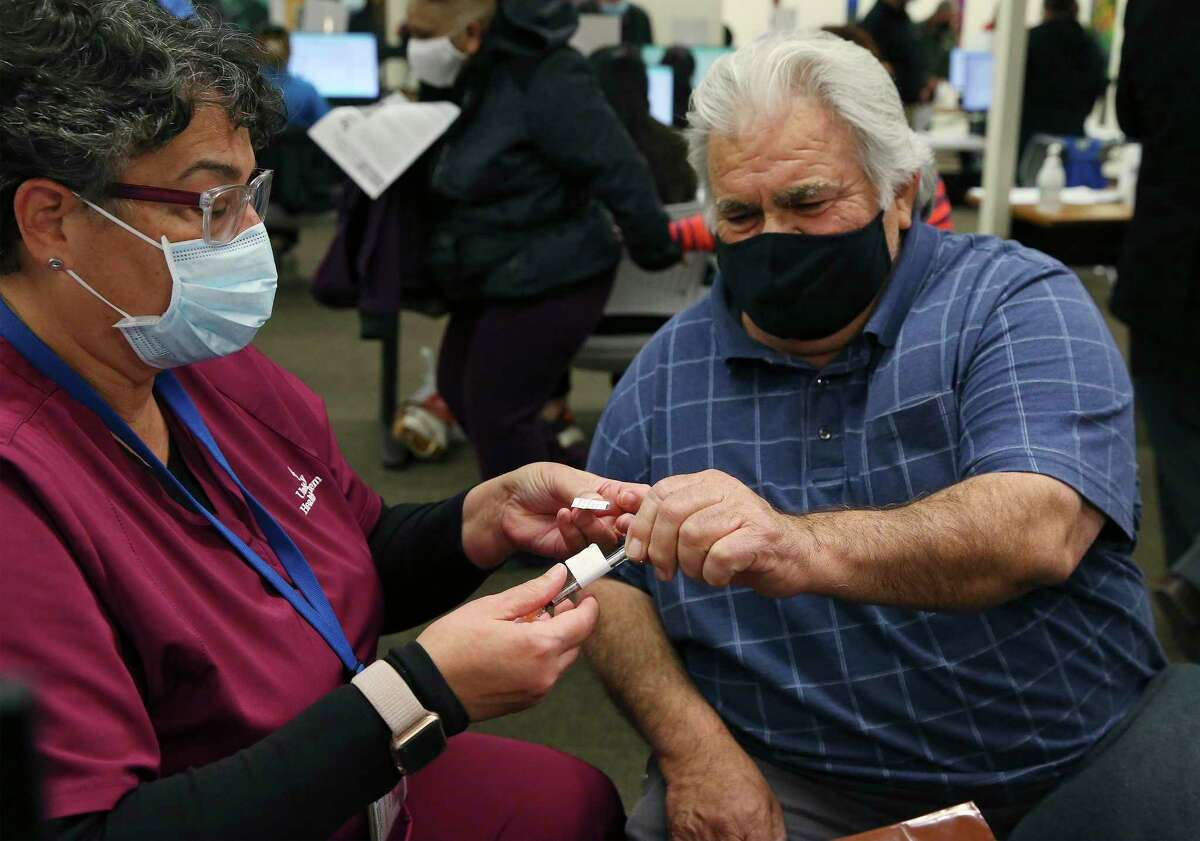 A man gets vaccinated in February. These days, the city is offering $100 gift cards for people to get vaccinated. A reader says common sense should suffice.