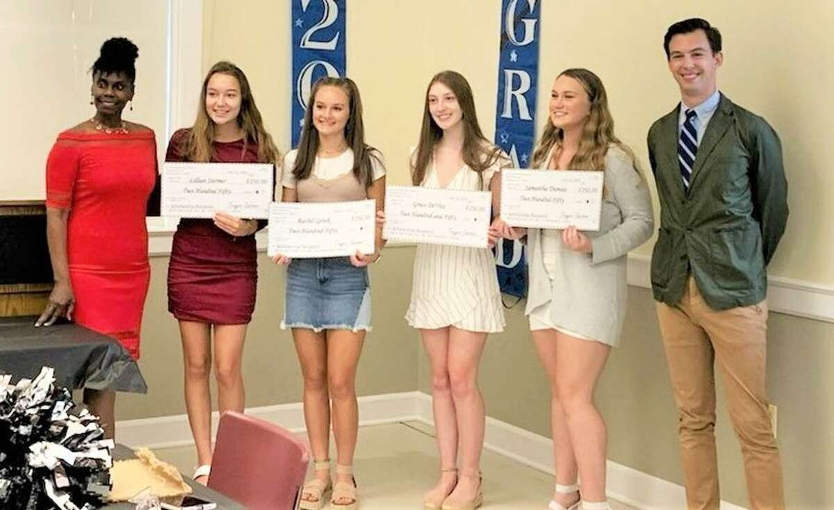 The Loud Energetic Noisy Award Cheerleader Scholarship Fund held its banquet July 12 at the deKoven House in Middletown. From left are Trayce Santoro, Cromwell High School student Lilian Stermer, Mercy High School students Rachel Getek and Grace DeVito, Portland High School student Samantha Dumais and Mayor Ben Florsheim.