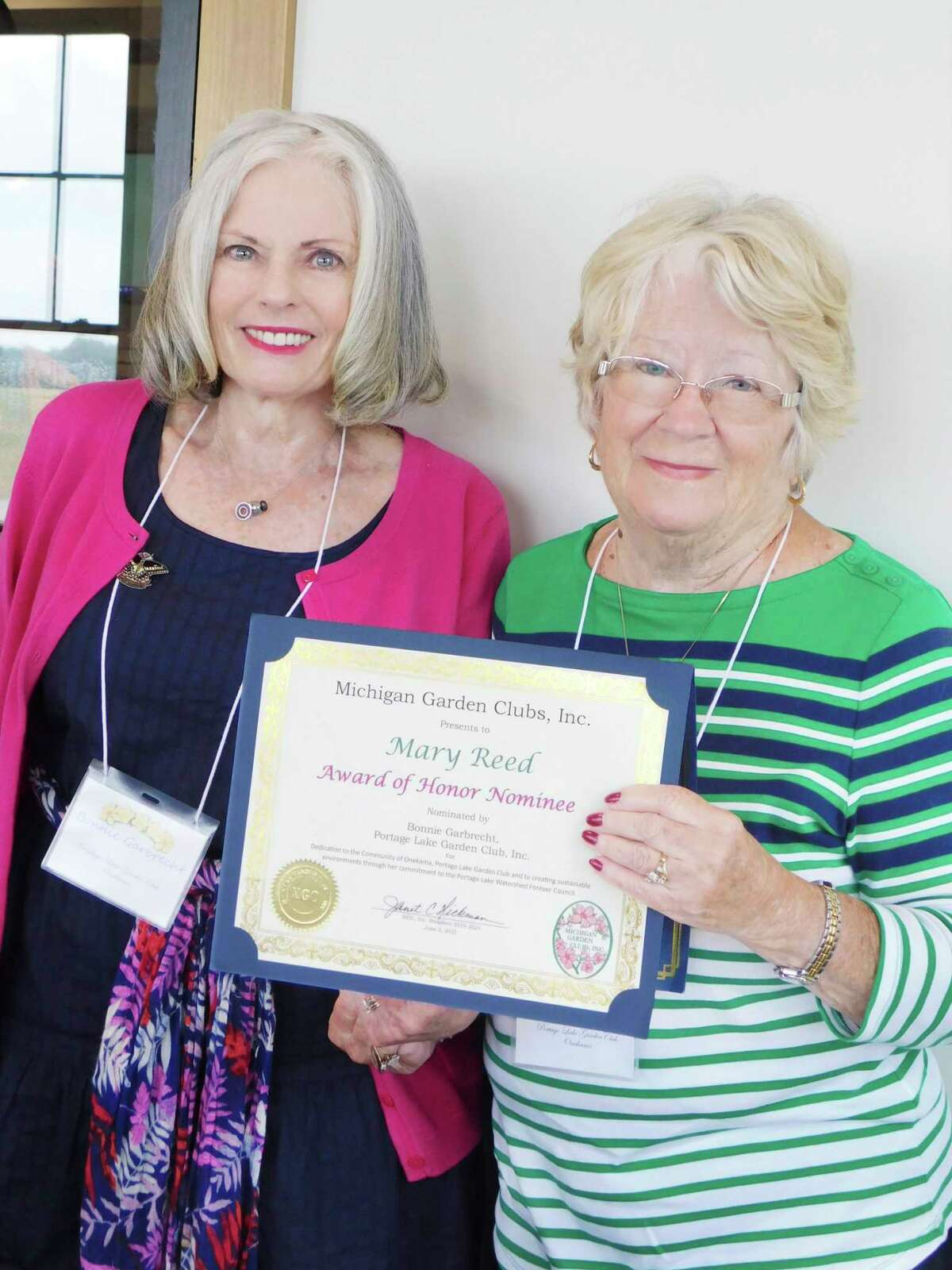 Mary Reed, of Onekama, has been nominated for theMichigan Garden Club Award of Honor. She is pictured withPortage Lake Garden ClubPresident Bonnie Garbrecht. (Courtesy photo/Chris Gravlin)