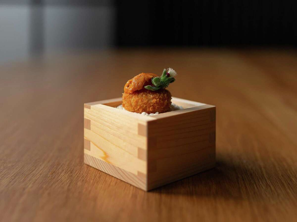 A Japanese croquette topped with Hokkaido uni is one of Restaurant Nisei's first bites on the tasting menu.