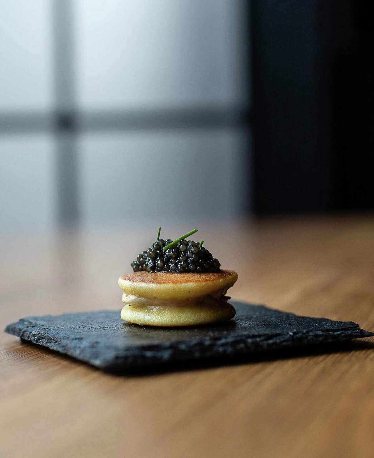 A banana-filled dorayaki is topped with caviar and chives at Restaurant Nisei in San Francisco.