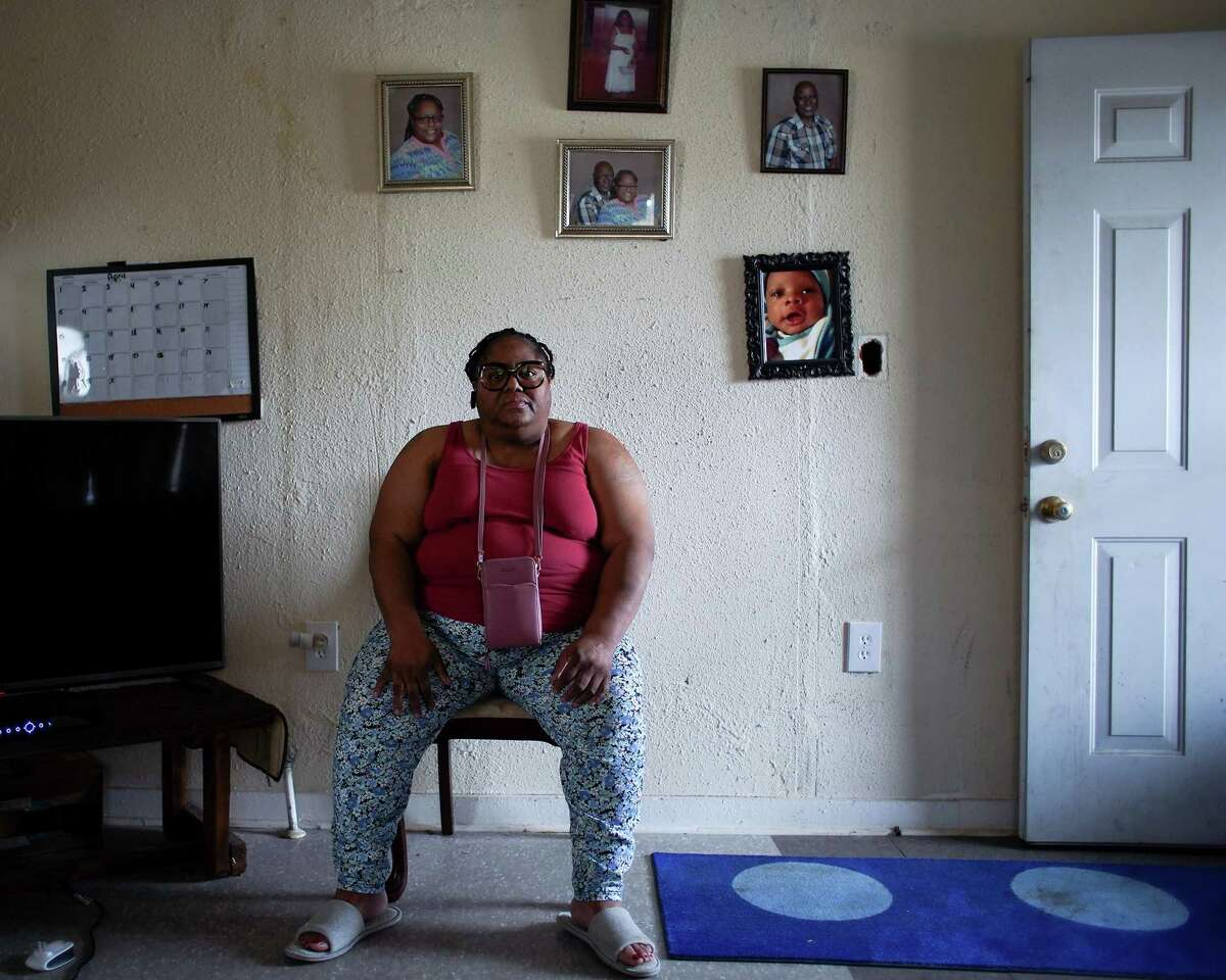 Shonza Branch, 56, sits in her northeast Houston on Thursday, Feb. 25, 2021. Her home was heavily damage during Hurricane Harvey, and she has been unable to fully repair it, during last week's storm, she lost water and has gone without for over a week.