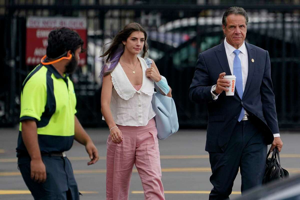 New York Gov. Andrew Cuomo, right, prepares to board a helicopter with his daughter Michaela Cuomo after announcing his resignation, Tuesday, Aug. 10, 2021, in New York. Cuomo says he will resign over a barrage of sexual harassment allegations. The three-term Democratic governor's decision, which will take effect in two weeks, was announced Tuesday as momentum built in the Legislature to remove him by impeachment.