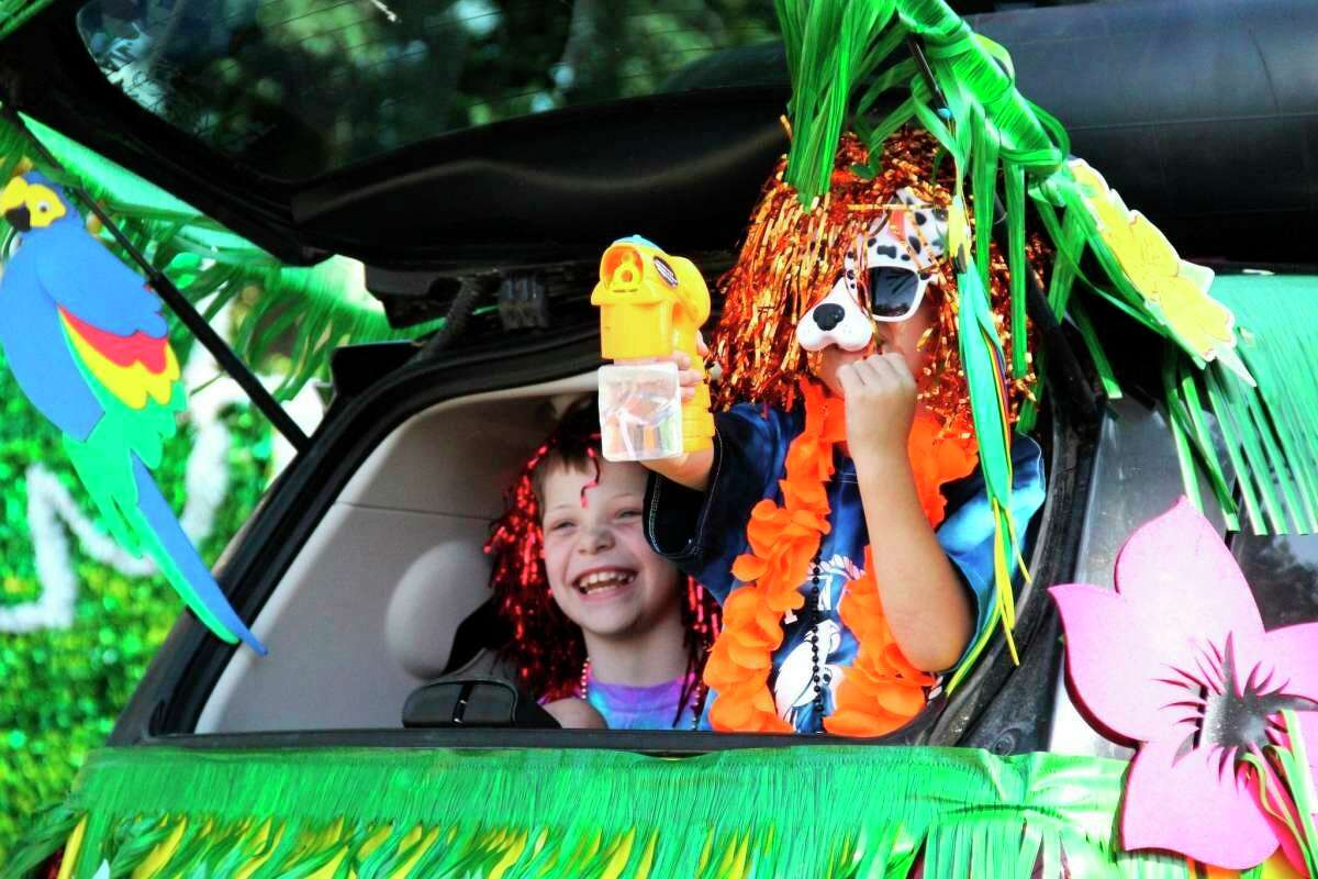 The 2019 Parade of Tropical Fools winds its way through a packed crowd in Caseville. (Andrew Mullin/Huron Daily Tribune)