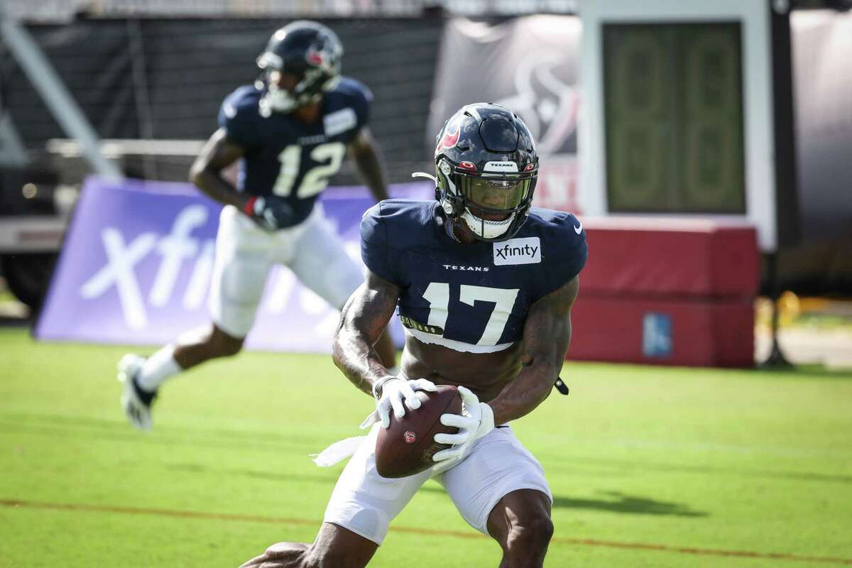 Houston Texans wide receiver Anthony Miller (17) turns upfield after a catch a football during an NFL training camp football practice Tuesday, Aug. 10, 2021, in Houston.