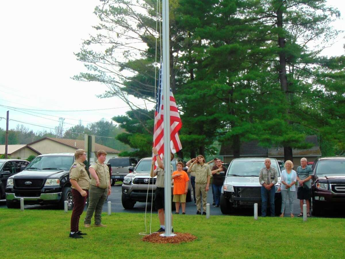 Members of Boy Scout Troop 61 raised the new American flag. (Star photo/Shanna Avery)