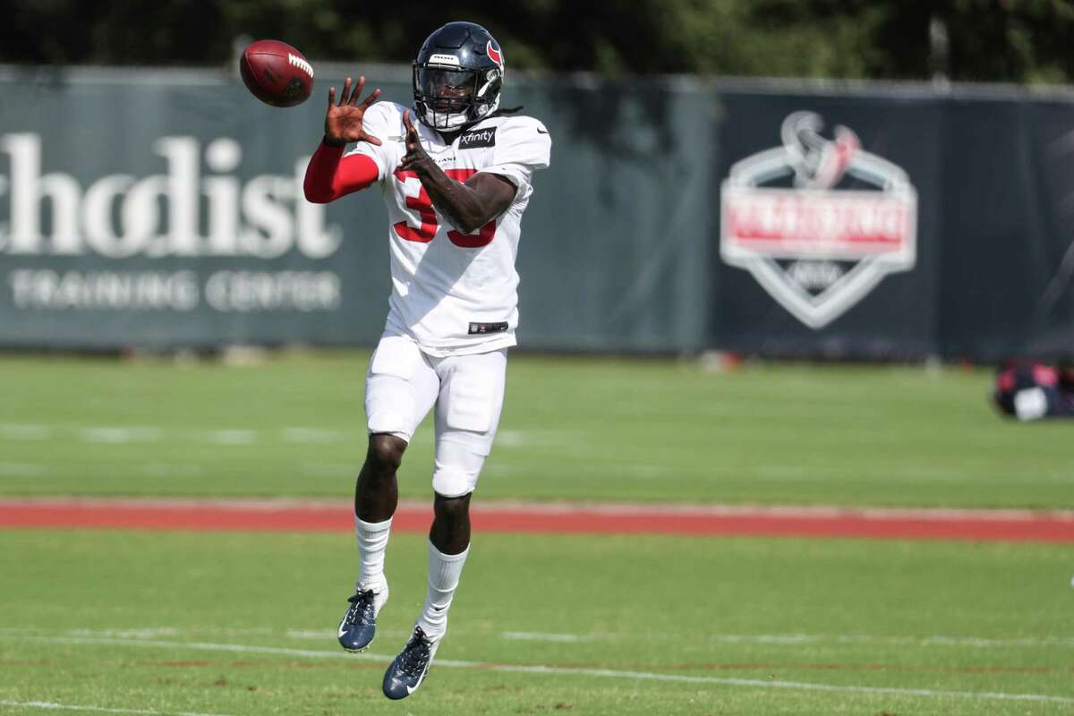 Houston Texans defensive back Keion Crossen leaps to make a catch during an NFL training camp football practice Tuesday, Aug. 10, 2021, in Houston.