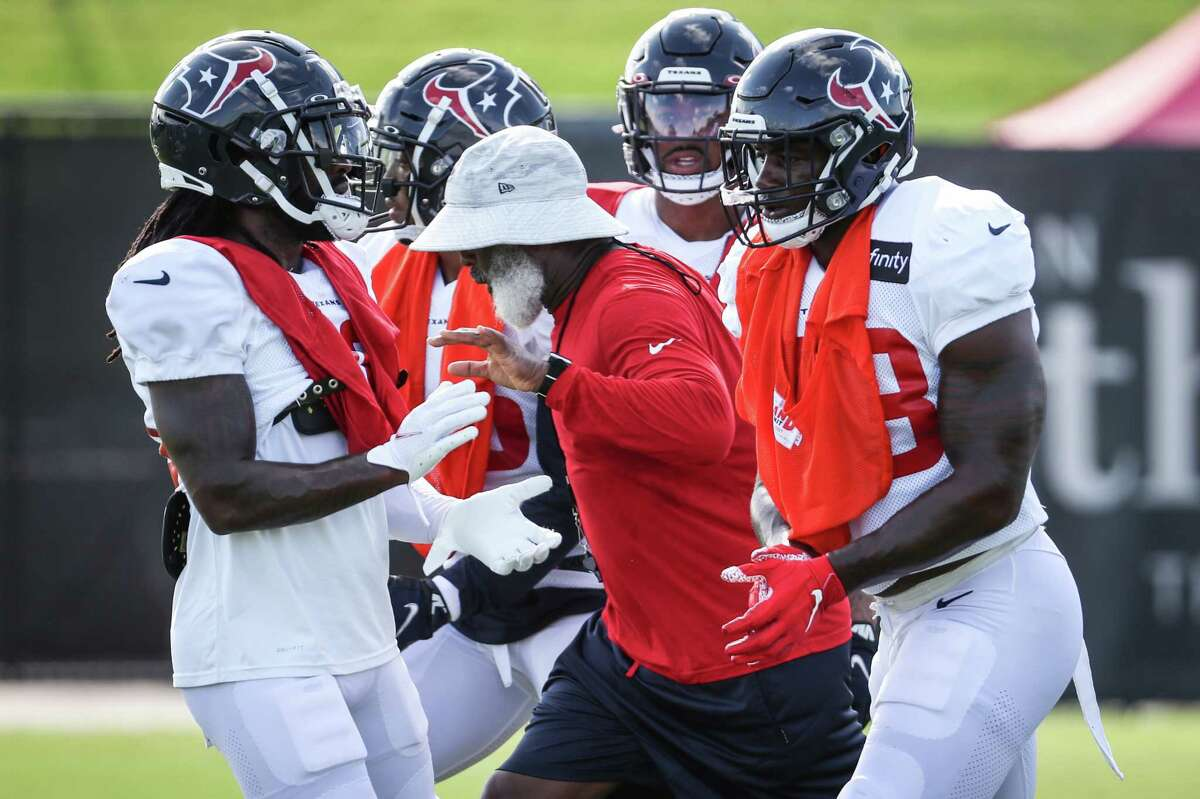 Houston Texans defensive coordinator Lovie Smith works with the defense during an NFL training camp football practice Tuesday, Aug. 10, 2021, in Houston.