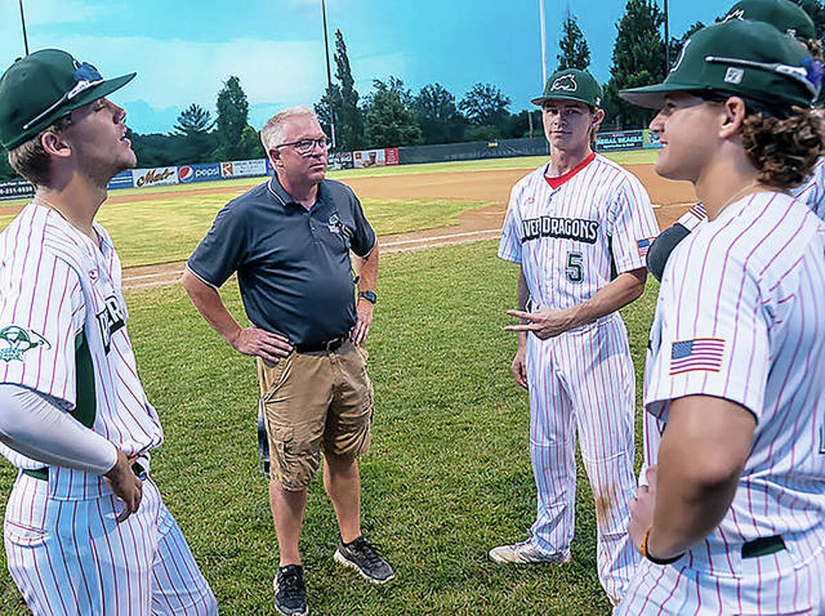 Alton River Dragons general manager Dallas Martz, center, speaks with players prior to a game this season at Lloyd Hopkins Field in Gordon Moore Park.