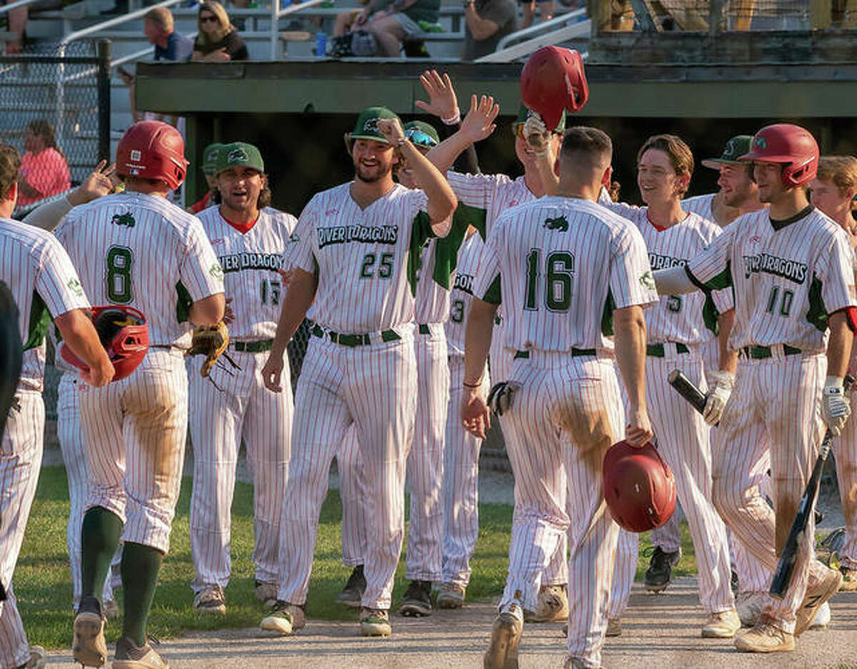 Alton River Dragons players celebrate during a Prospect League game this season at Lloyd Hopkins Field.