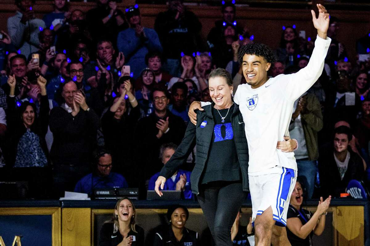 """The Spurs' Tre Jones and his mother Debbie Jones receive an ovation during his time at Duke. Tre is happy to have his mom - a breast cancer survivor - back in the stands to watch him during summer league. Said Tre: """"I hear her voice always."""""""
