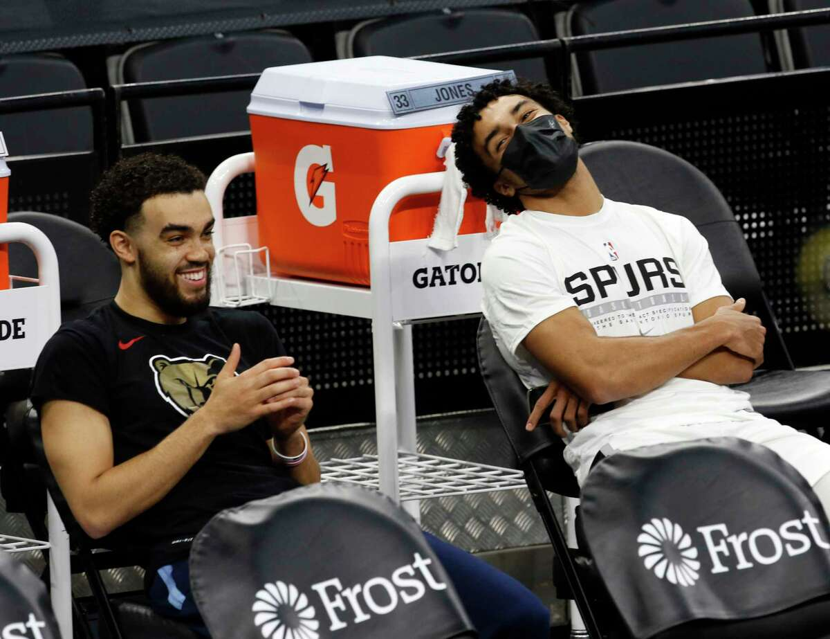 Tyus Jones, left, of the Memphis Grizzlies shares a light moment with his brother, Tre Jones of the Spurs, before the start of their game at AT&T Center on Jan. 30, 2021 in San Antonio.