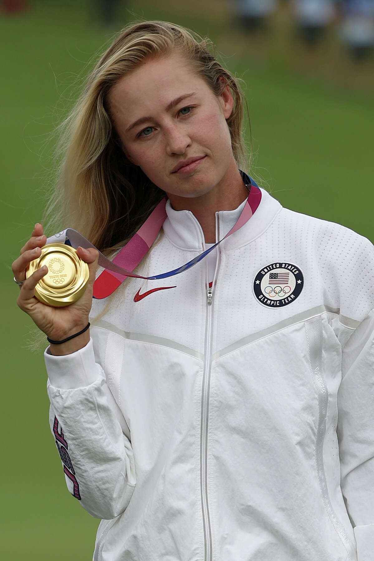 KAWAGOE, JAPAN - AUGUST 07: Nelly Korda of Team United States celebrates with the gold medal at the victory ceremony after the final round of the Women's Individual Stroke Play on day fifteen of the Tokyo 2020 Olympic Games at Kasumigaseki Country Club on August 07, 2021 in Kawagoe, Japan.