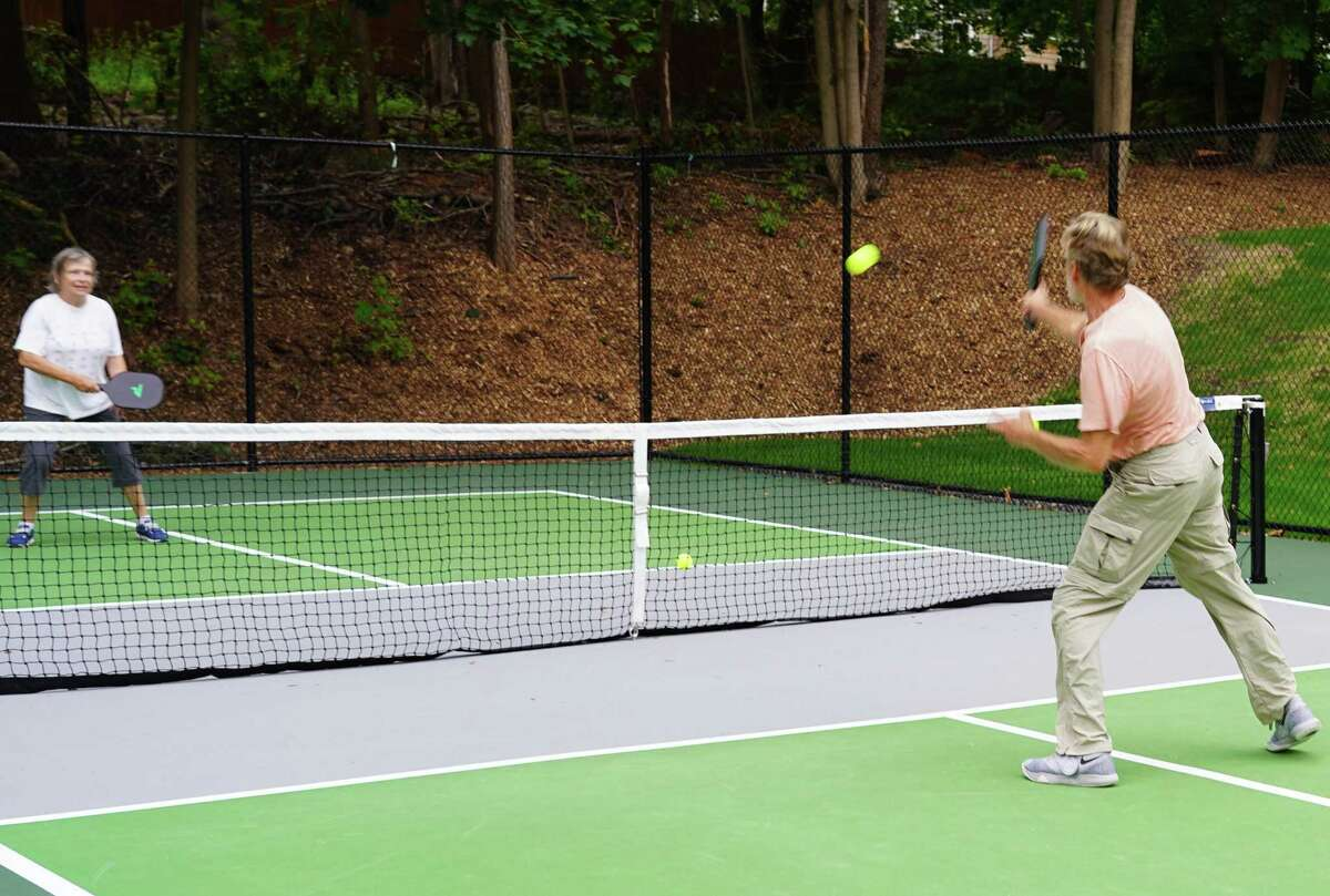 Juliana Post and John Clausen were playing pickleball on the new courts in Mead Memorial Park in New Canaan on Aug. 10, 2021.