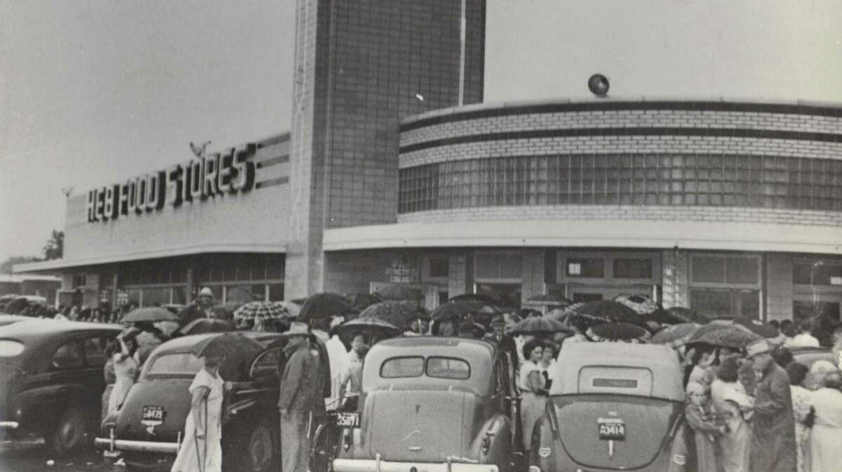 Customers crowd around the entrance of the H-E-B store at 1601 Nogalitos St. in April 1945, the month the store opened. In 2014, the grocer remodeled the old building, tearing out much of it but keeping the original facade.
