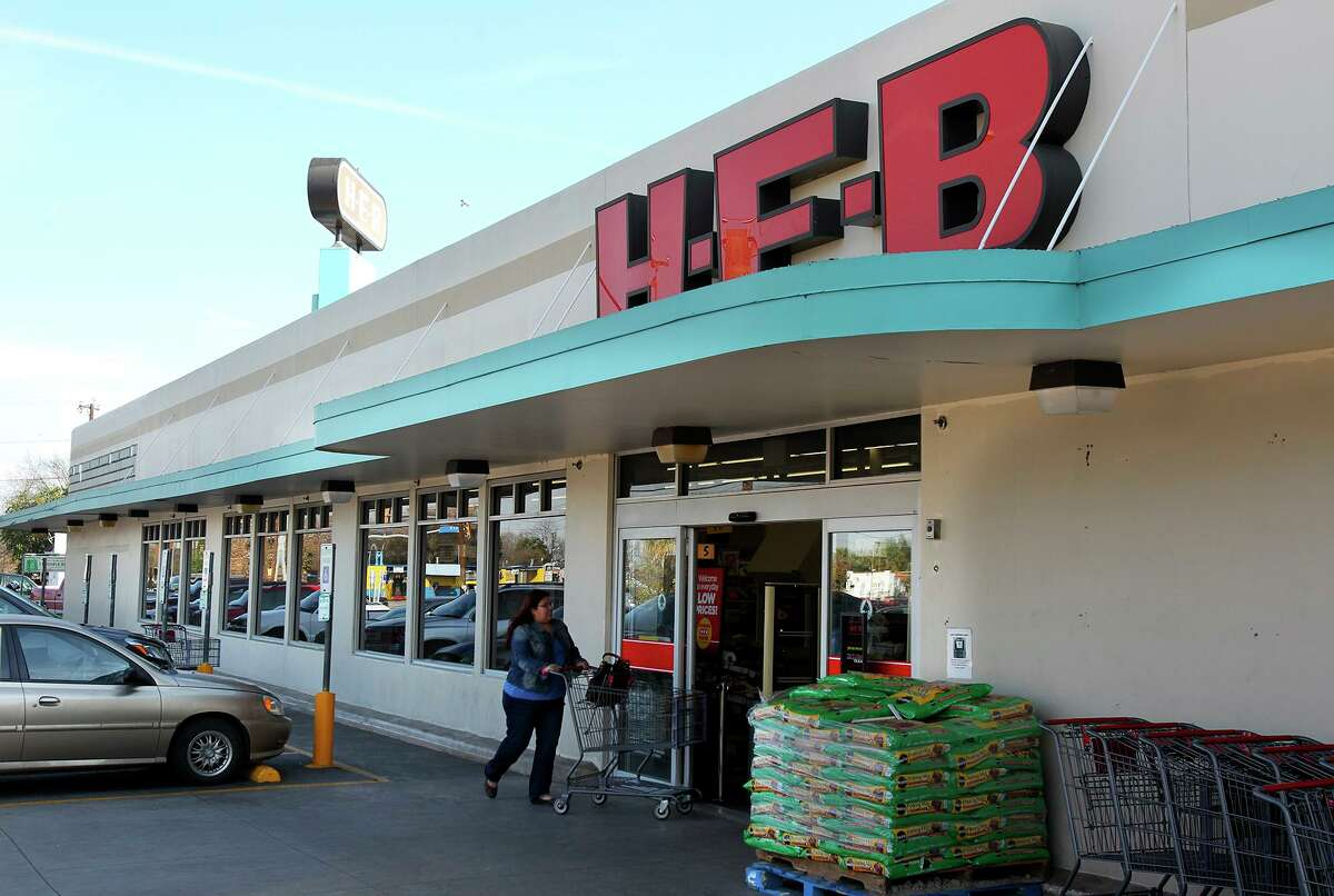 Customers visit the H-E-B at 1601 Nogalitos in February 2014. The grocer later tore down much of the old building - except for its original facade and monolithic sign - and replaced it with a larger multilevel store.