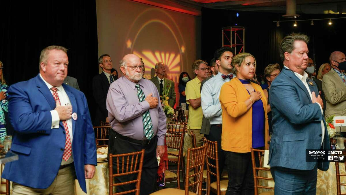Guests at the Missouri City State of the City Gala stand for the National Anthem on Thursday, Aug. 5, at the City Hall Complex.