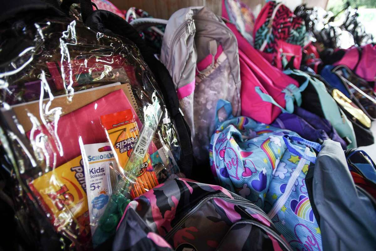 Cypress Cars & Coffee presents a back-to-school backpack drive on Aug. 21 at Fairfield Baptist Church. Shown here, backpacks line a table during a giveaway of backpacks loaded with school supplies at Roberts Park on Aug. 10, 2019.