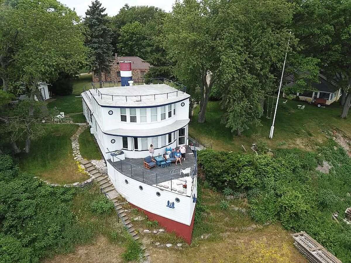 A distinctive home that recently hit the market in Michigan offers beautiful views of Lake Huron from both its port and starboard sides.