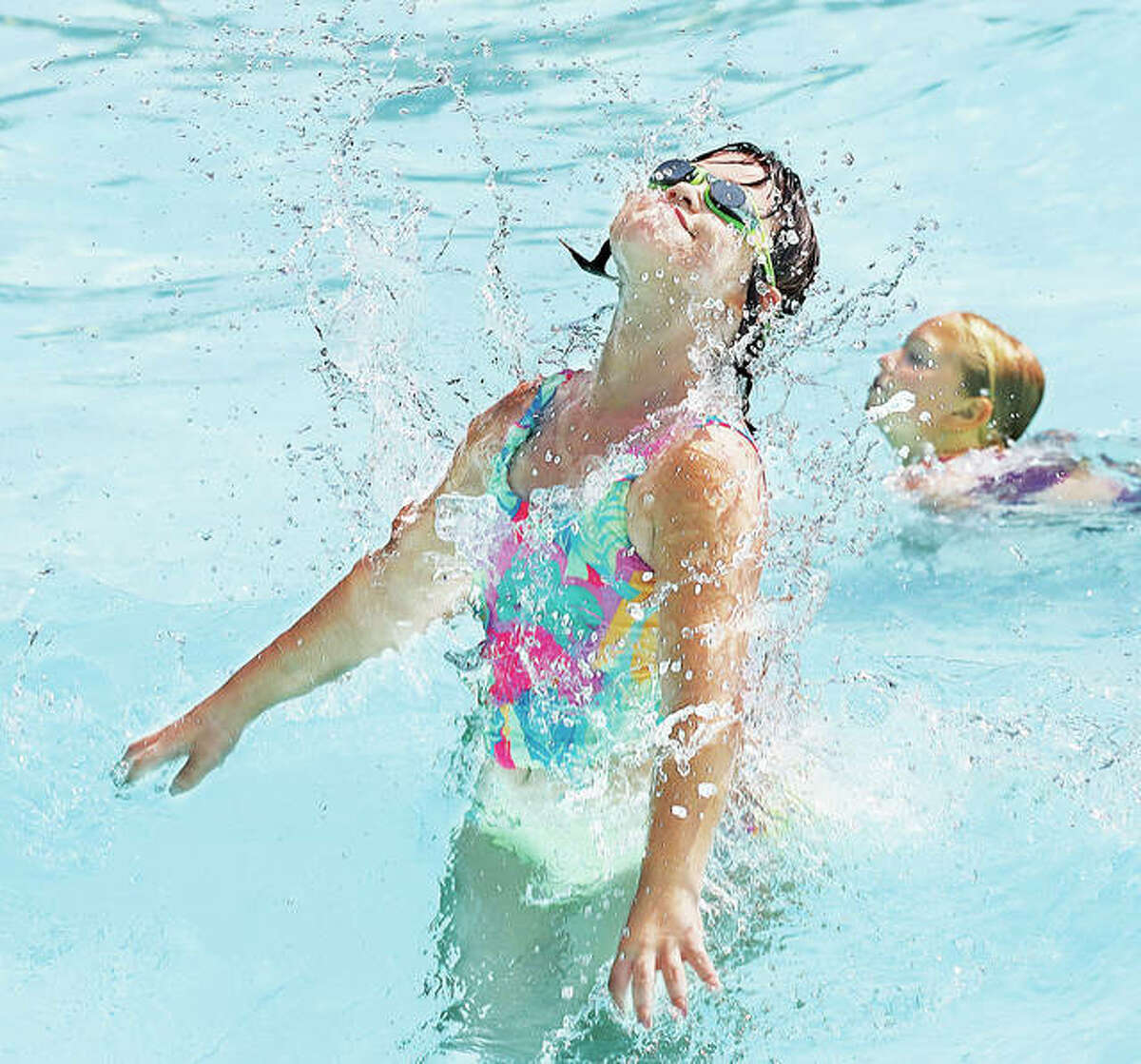 A young girl leaps out of the water Tuesday like a dolphin in the Breaker Beach wave pool at Grafton's Raging Rivers Water Park on the Great River Road. A large crowd was already at the water park shortly after its opening Tuesday as people sought relief from the heat and humidity. The park opens daily at 10:30 a.m. For more details call 618-786-2345. For more photos, visit www.thetelegraph.com. - John Badman|The Telegraph