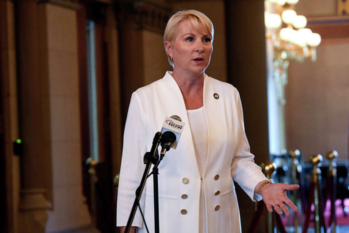Assemblywoman Mary Beth Walsh, R- Ballston Spa, speaks to reporters at the state Capitol, Tuesday, Aug. 10, 2021. (AP Photo/Hans Pennink)