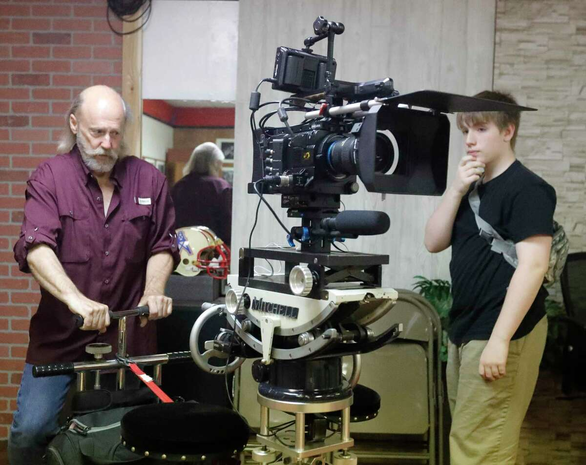 """Film instructor Gary Parker adjusts the camera for the film class' first movie """"Escape from Film School"""" at the Indie Film Foundation Studio, Saturday, July 31, 2021, in Conroe."""