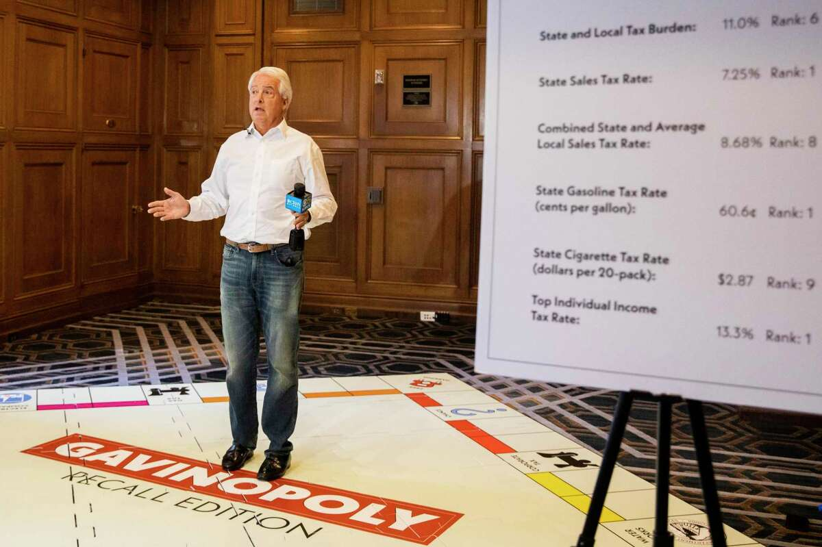 Republican candidate in the recall election for California governor John Cox stands on a makeshift Monopoly board to represent high costs in the state during a press conference held at Westin St. Francis in San Francisco.