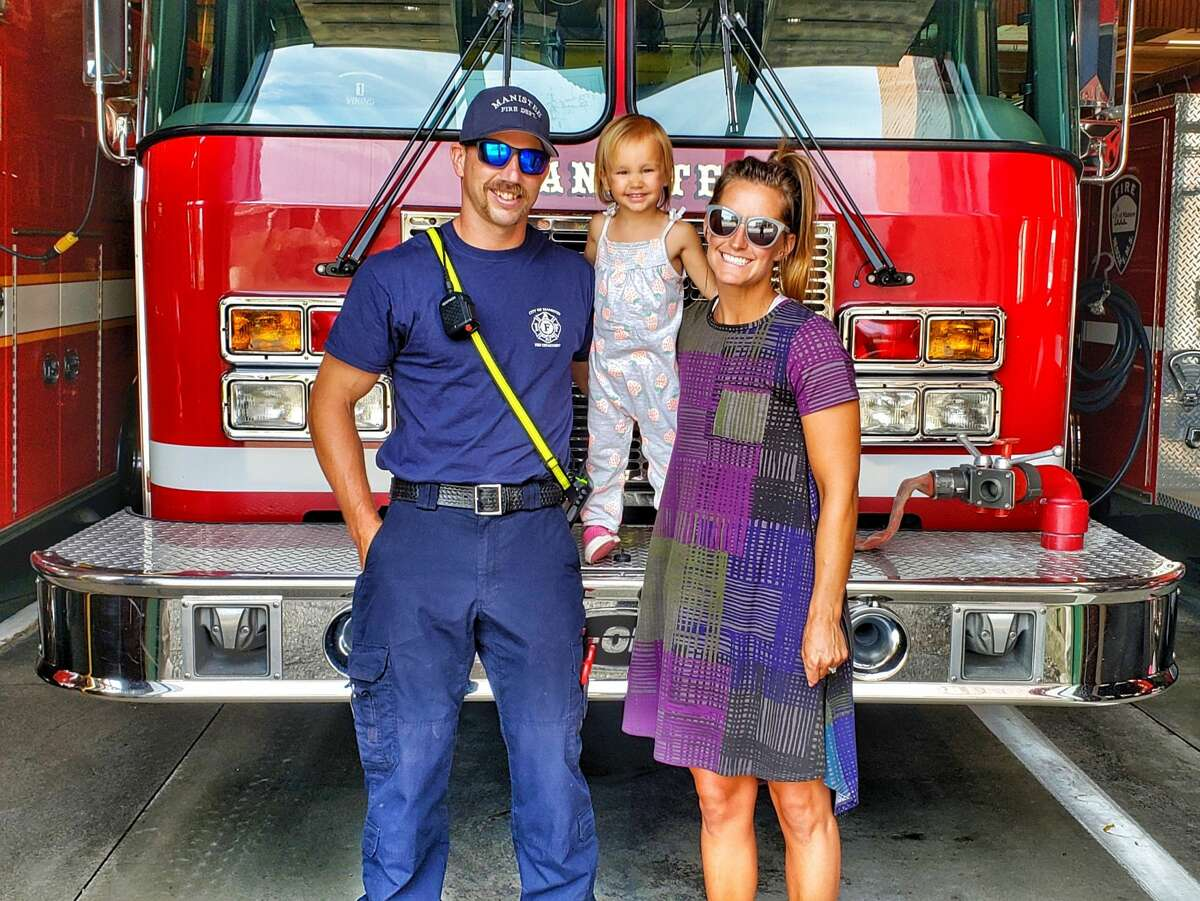 (From left) John Robydek, Naylee Robydek and Tiffany Robydek are shown in front of the Manistee City Fire Department. John Robydek started at the fire department in 2019 and is now working to also become a paramedic.