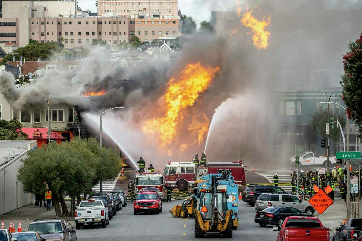 Firefighters battle a fire following an explosion at Geary boulevard and Parker Avenue. The National Transportation Safety Board released the results of its investigation into the incident, finding that while a contractor was mostly to blame, Pacific Gas & Electric Co. did not employ software that could have helped locate shutoff valves faster.