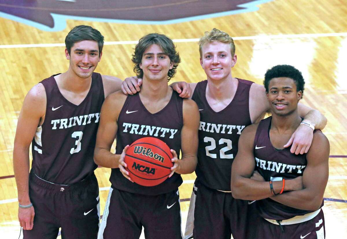 Ben Hanley, from left, Tanner Brown, AJ Clark and Kaleb Jenkins are a group of Trinity basketball players who helped the USA women's 3-on-3 team prepare ahead of the squad's gold-medal performance.