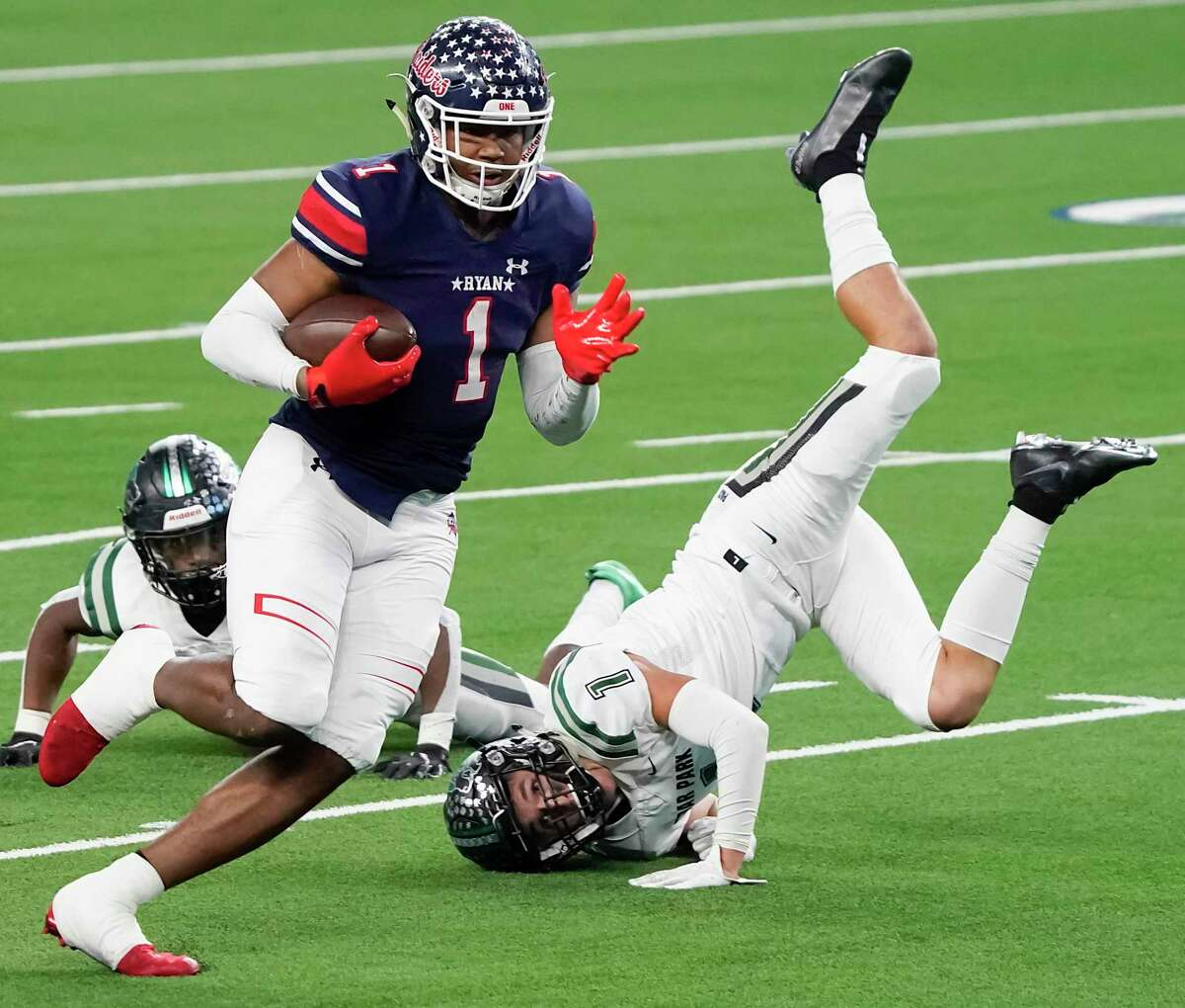 Denton Ryan wide receiver Ja'Tavion Sanders (1) gets past Cedar Park defensive back Cody Marshall during the first half of the Class 5A Division I Texas state football championship game at AT&T Stadium on Friday, Jan. 15, 2021, in Arlington, Texas. (Smiley N. Pool/The Dallas Morning News)