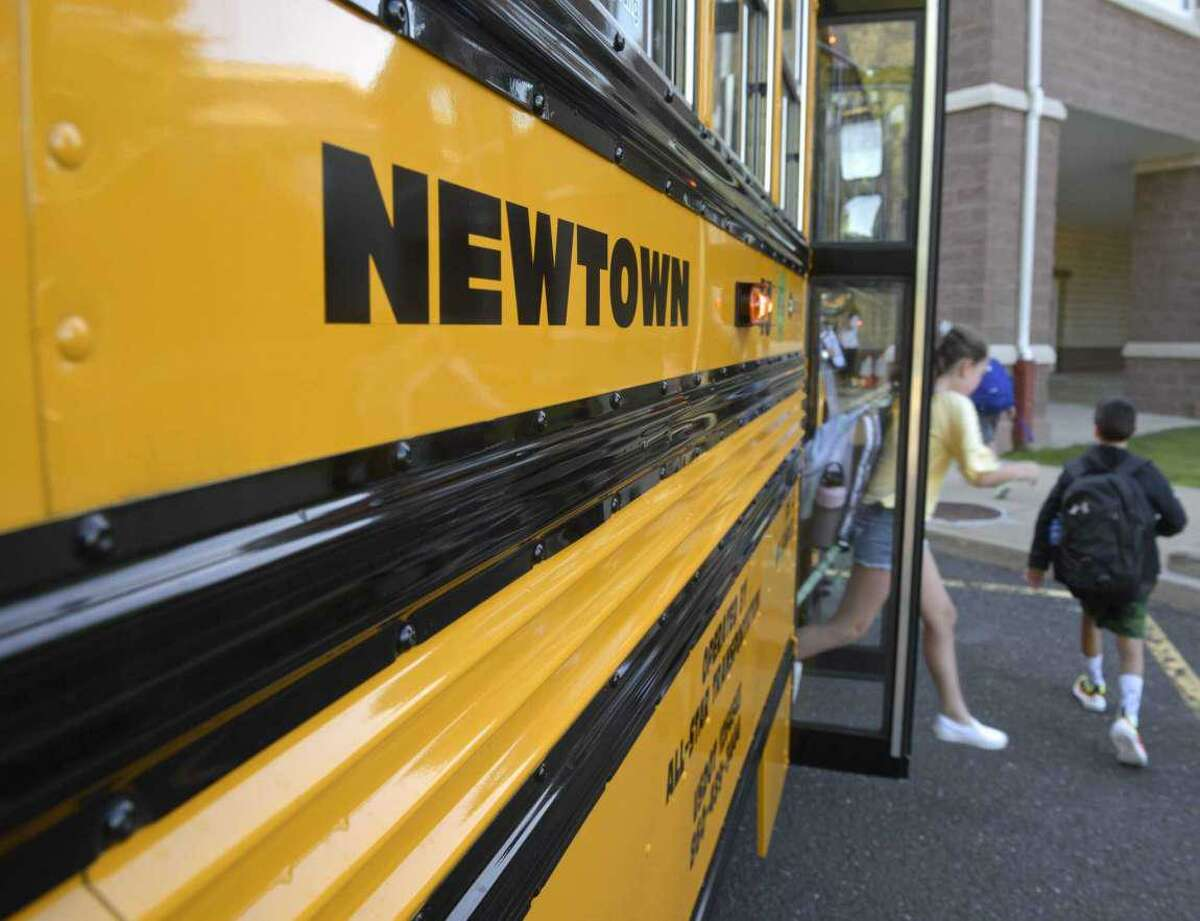 File photo. Students get off the school bus for their first day of school at Reed Intermediate School. Monday, August 26, 2019, Newtown, Conn.