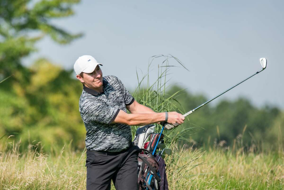 Kyle Downey of Locust Hill watches a shot during the first round of the State Amateur golf championship Tuesday, Aug. 10, 2021, at Schuyler Meadows. Downey, a former Siena basketball player, holds the first-round lead after a 6-under-par 66. (Dan Thompson/NYSGA)