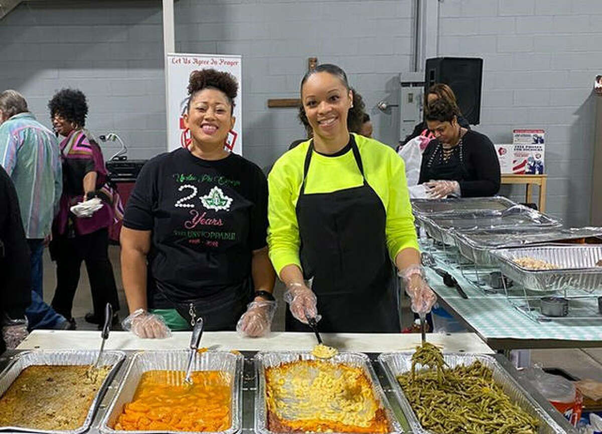 Upsilon Phi Omega members Chantay White and Dina Thomas serve Thanksgiving Dinner at Soup N Share on Nov. 28, 2019, in Granite City. UPO is the alumni chapter of Alpha Kappa Alpha Sorority.