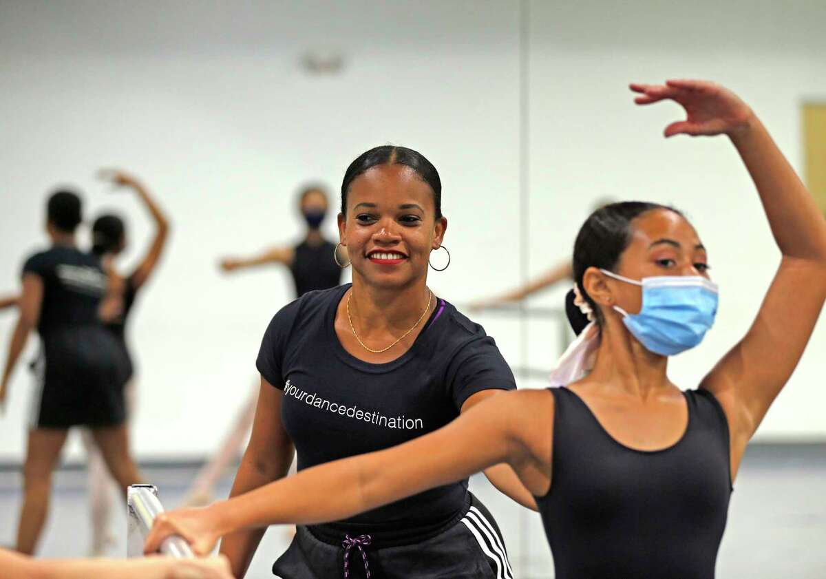 Danielle Campbell Steans, who started the San Antonio Ballet School in Castle Hills instructs Jasmine Melvin on Wednesday, July 28, 2021.