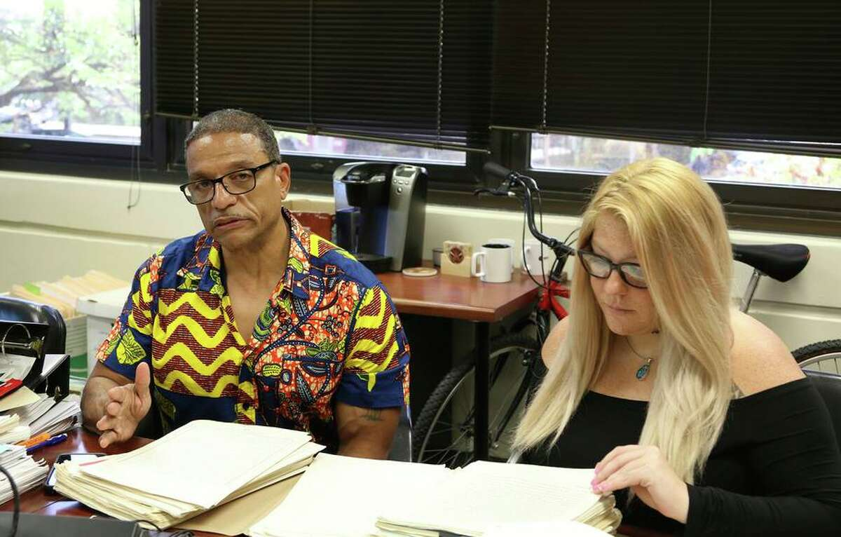 In this Tuesday, Sept. 3, 2019 photo, Hawaii Innocence Project co-director Kenneth Lawson, left, explains the case of a former U.S. soldier convicted of a 1982 murder, while University of Hawaii law student Alanna Wade looks through the legal file in Honolulu. His conviction can't be challenged by later-developed DNA evidence because he was tried by court-martial, a federal appeals court ruled Tuesday.