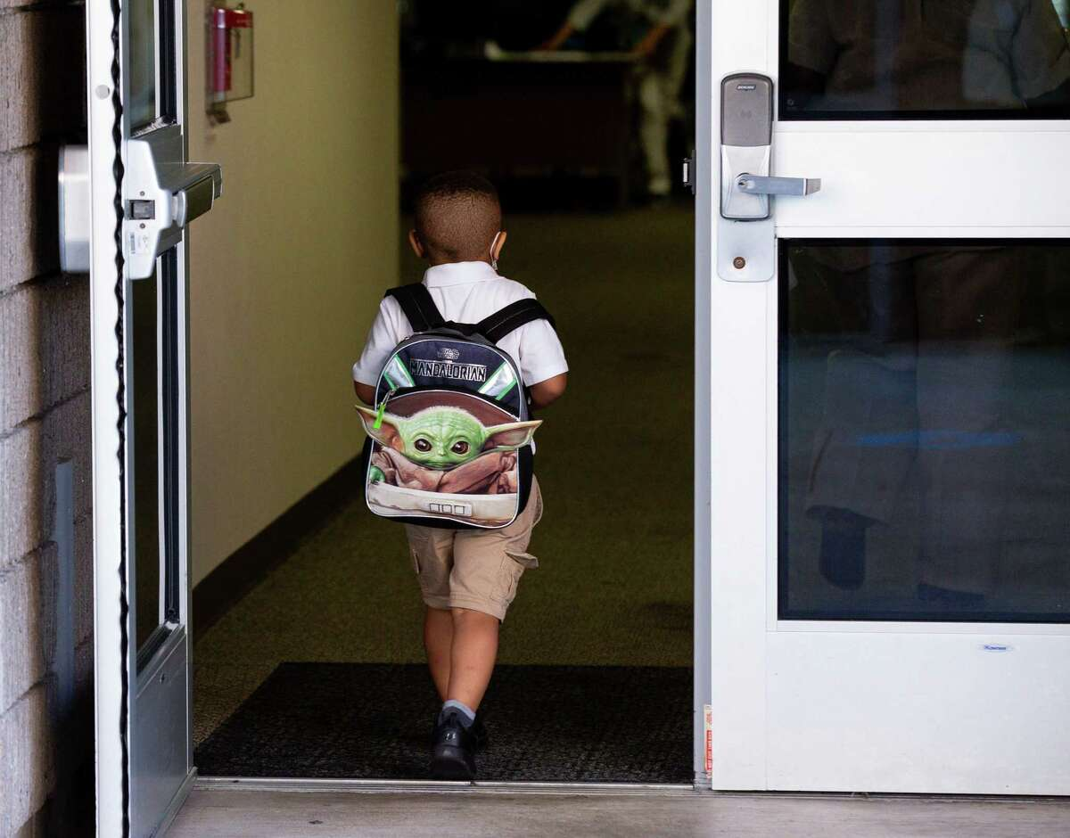 A kindergartener heads to his classroom during the first day of school at Heflin Elementary on Tuesday, Aug. 10, 2021, in Houston.