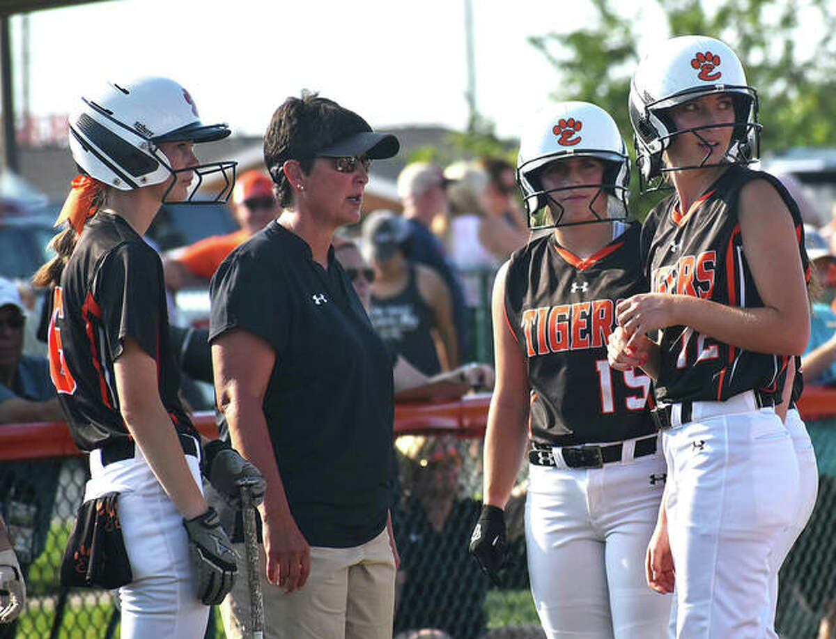 Edwardsville coach Lori Blade (second left) talks with some of her Tigers during a game last season. Blade is the 2021 Telegraph Large-Schools Softball Coach of the Year.