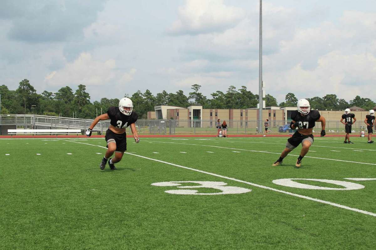 Kingwood linebackers Pablo Cantu (left) and Grant Golden (right) going through drills during fall camp.