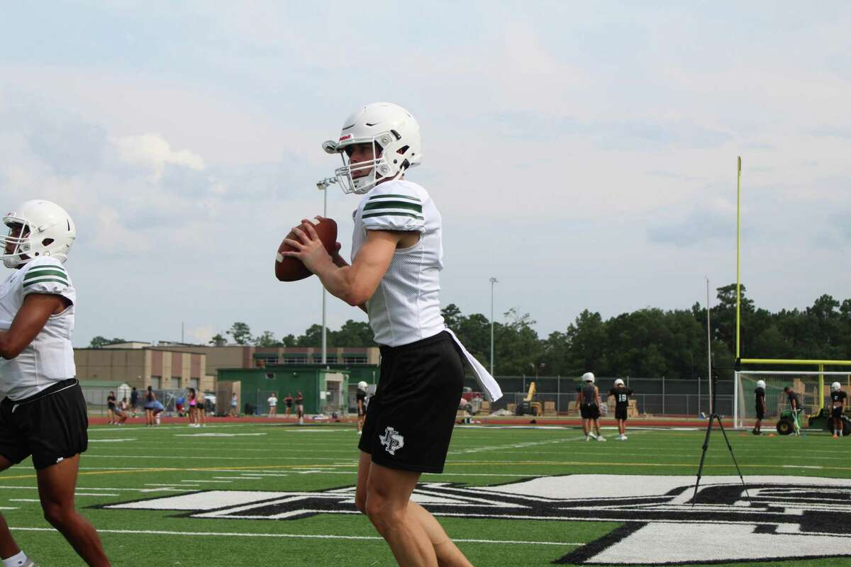 Kingwood Park quarterback Patrick Overmyer going through passing drills during fall camp.