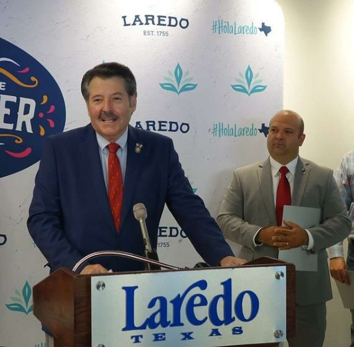 Pictured is Laredo Mayor Pete Saenz speaking as officials including Councilmember Ruben Gutierrez, right, welcome the city of San Mateo Atenco on July 29.