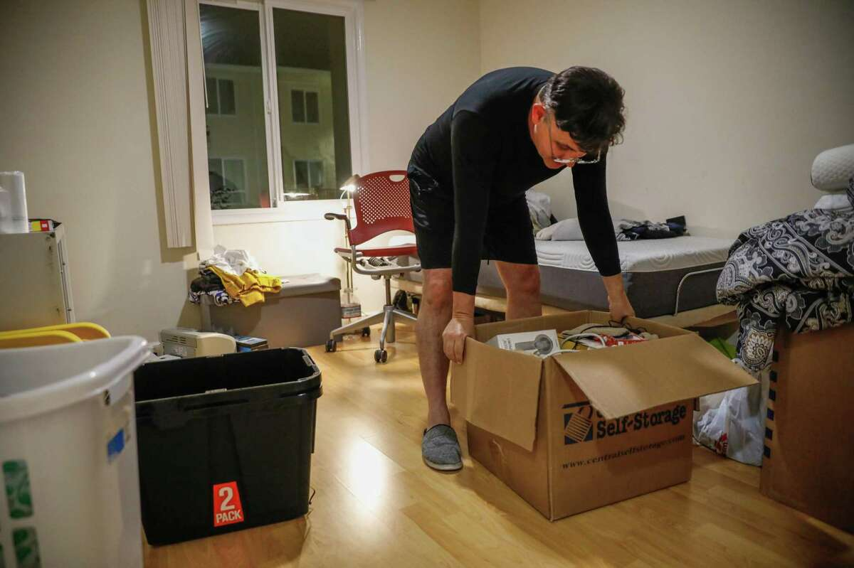 Marcelo Moraes packs up his apartment following a court-ordered eviction on Saturday, July 31, 2021 in Daly City, Calif. Moraes owes $47,000 in back rent after losing work due to the pandemic as well as being sick in February 2020.